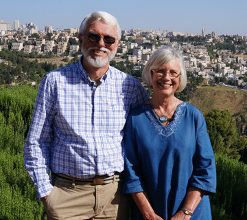 Bob & Kathryn Carlton being interviewed for Peacemakers: Crossing the Divide overlooking the Old City of Jerusalem with the Mt of Olives in the background